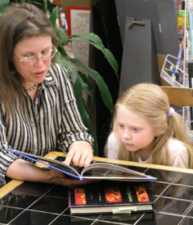 Jessie Haas reading to Grace McNeil in 2005